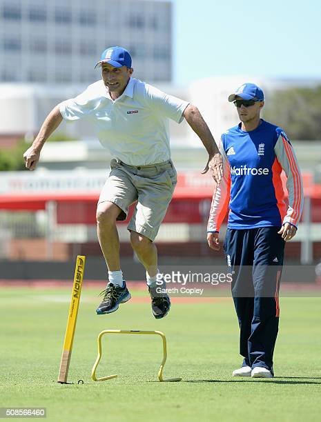 Former England captain Nasser Hussain takes part in a fitness drill alongside Joe Root during a nets session at St George's Park on February 5 2016...