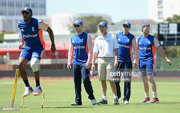 Former England captain Nasser Hussain takes part in a fitness drill alongside Chris Jordan England captain Eoin Morgan Joe Root and Ben Stokes during...