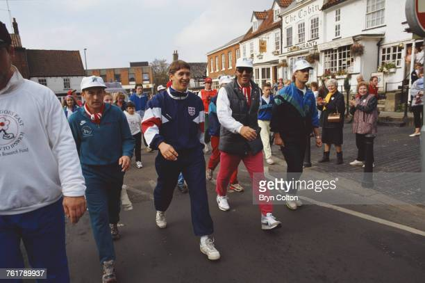 Former England Cricket captain Ian Botham is greeted by well wishers as he is joined by England Football captain Gary Lineker as he completes a stage...