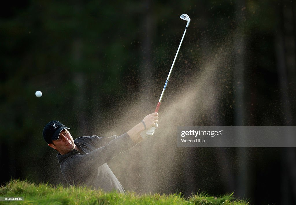 Former England cricket captain Michael Vaughan hits the lip of the bunker on the ninth hole and remains in the bunker during the first round of The...