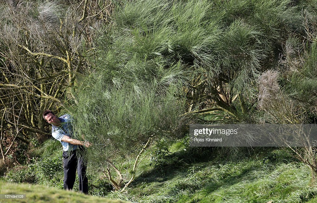 Former England cricket captain Michael Vaughan plays out from the trees on the first hole during the final practice round of The Alfred Dunhill Links...