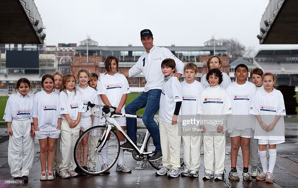 Former England cricket captain Michael Vaughan poses for a picture with children from Chance to Shine to launch the Michael Vaughan Charity Bike Ride to raise funds for the Laureus Sport for Good Foundation and Chance to Shine, on January 14, 2013 in London, England.