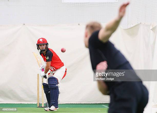 Former England cricketer Andrew Flintoff bowls to friend and Women's Melbourne Renegades BBL cricketer Danni Wyatt during a nets session at Melbourne...