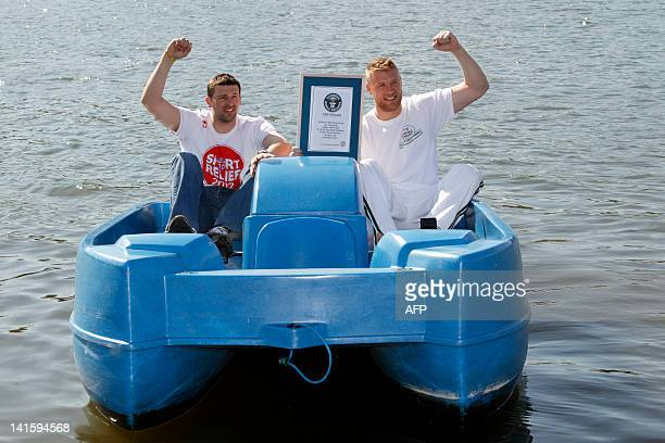 Former England cricketer Andrew 'Freddie' Flintoff and friend and England cricketer Steve Harmison celebrate with their official certificate after a...