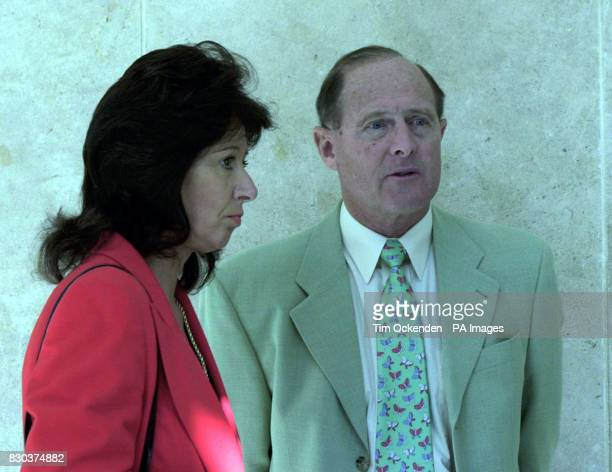 Former England cricketer Geoffrey Boycott with his current girlfriend Rachel Swinglehurst leaves the court of Appeal in AixenProvence after losing...