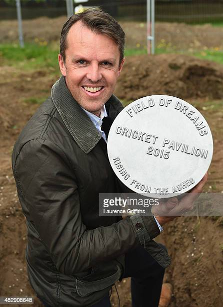 Former England Cricketer Graeme Swann buries a time capsule at the construction site of the new Pavilion during the Field of Dreams launch at the...