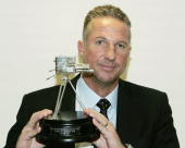 Former England cricketer Ian Botham poses with the Lifetime Achievement Award during the BBC Sports Personallity of the Year Award on December 12...