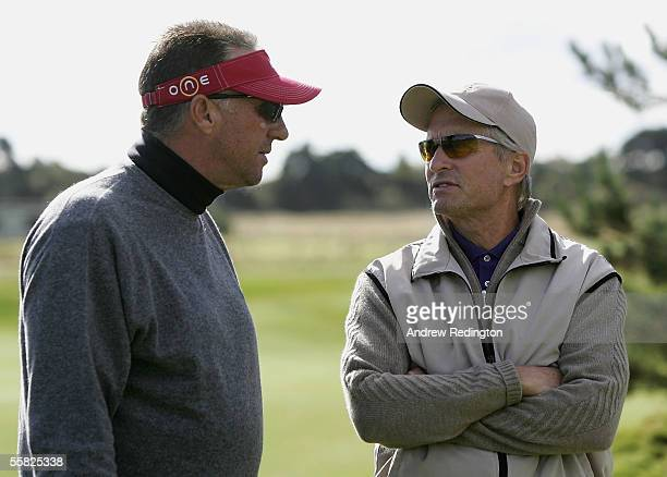 Former England cricketer Ian Botham talks with actor Michael Douglas during the first round of the Dunhill Links Championships at the Carnoustie Golf...