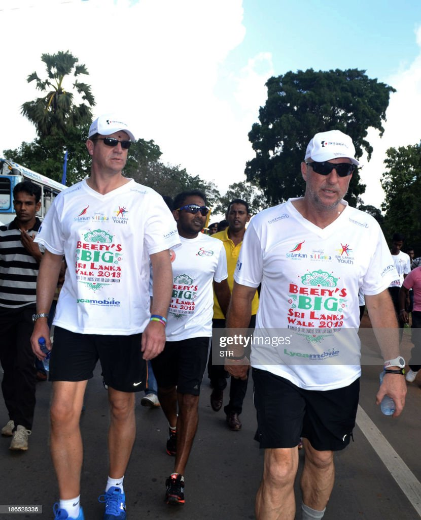 Former England cricketer Ian Botham walks with others as he launches his charity walk from the northern Sri Lankan town of Kilinochchi on November 1...