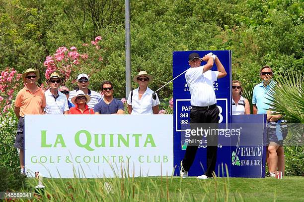 Former England football manager Fabio Capello watches current leader Mike Harwood of Australia during the second round of the Benahavis Senior...