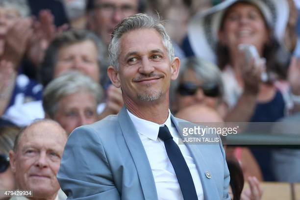 Former England footballer and television presenter Gary Lineker stands and waves in the royal box on centre court before the start of the men's...