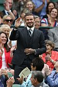 Former England footballer David Beckham stands in the royal box on centre court as he is introduced on the sixth day of the 2016 Wimbledon...