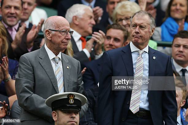 Former England footballers Bobby Charlton and Geoff Hurst stand in the royal box on centre court as they are introduced on the sixth day of the 2016...