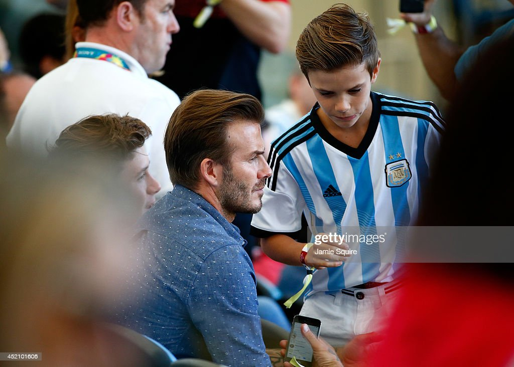 Former England international David Beckham and sons Brooklyn Beckham (L) and Romeo Beckham (R) prior to the 2014 FIFA World Cup Brazil Final match between Germany and Argentina at Maracana on July 13, 2014 in Rio de Janeiro, Brazil.