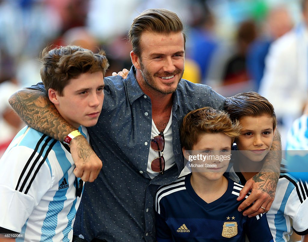 Former England international <a gi-track='captionPersonalityLinkClicked' href=/galleries/search?phrase=David+Beckham&family=editorial&specificpeople=158480 ng-click='$event.stopPropagation()'>David Beckham</a> and sons <a gi-track='captionPersonalityLinkClicked' href=/galleries/search?phrase=Brooklyn+Beckham&family=editorial&specificpeople=214623 ng-click='$event.stopPropagation()'>Brooklyn Beckham</a> (L), <a gi-track='captionPersonalityLinkClicked' href=/galleries/search?phrase=Cruz+Beckham&family=editorial&specificpeople=4337497 ng-click='$event.stopPropagation()'>Cruz Beckham</a> (2nd R) and <a gi-track='captionPersonalityLinkClicked' href=/galleries/search?phrase=Romeo+Beckham&family=editorial&specificpeople=171832 ng-click='$event.stopPropagation()'>Romeo Beckham</a> (R) prior to the 2014 FIFA World Cup Brazil Final match between Germany and Argentina at Maracana on July 13, 2014 in Rio de Janeiro, Brazil.