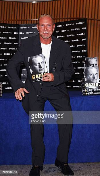 Former England International footballer Paul Gascoigne signs copies of his new autobiography 'Gazza My Story' at Books Etc Canary Wharf on June 22...
