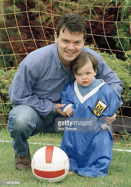 Former England midfield player Steve Hodge with his son Elliot who is wearing the infamous shirt worn by Diego Maradona in the 1986 World Cup...
