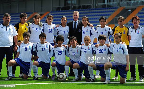 Former England player Sir Geoff Hurst poses with local players at the Opening Ceremony of Dalga stadium which will be a venue for the FIFA U17 WWC...