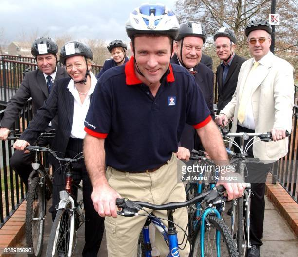 Former England rugby Captain Phil de Glanville gets on his bike with fellow Sport England Southwest executives Andrew Smith Alex Chisholm Jane...