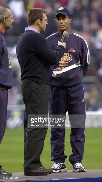 Former England rugby player Jeremy Guscott being interviewed about his charity walk on a podium at half time during the England versus Australia...