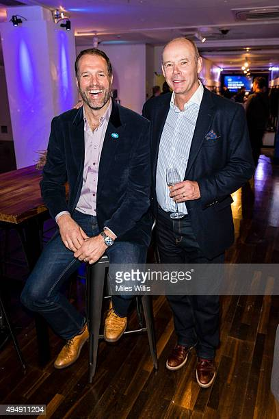 Former England rugby player Martin Johnson and former England Rugby team coach Sir Clive Woodward attend the AIG Rugby Industry Event Party at AIG...