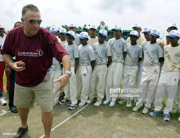 Former England's allrounder Ian Botham teaches Sri Lankan schoolboys the art of fast bowling at the Galle International Cricket Stadium 20 April 2005...