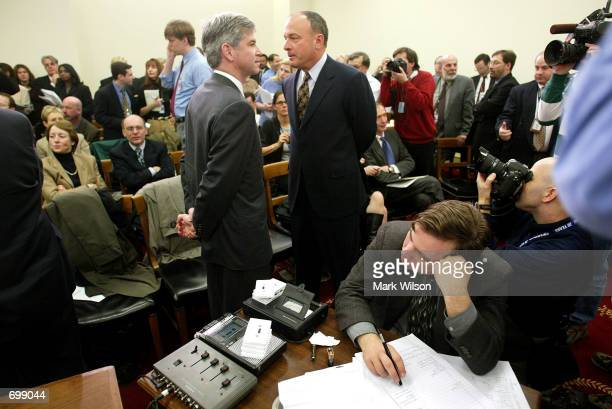 Former Enron Chief Financial Officer Andrew S Fastow speaks with his attorney John Keker as a court reporter rests his head during a break in the...