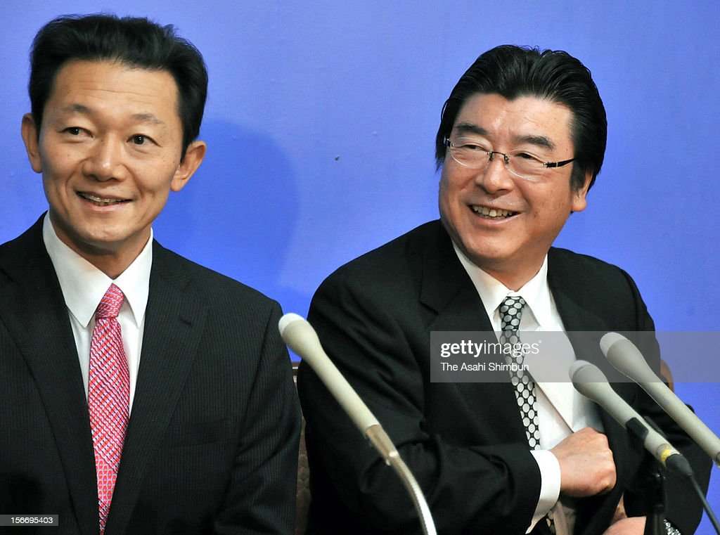 Former Environment Minister Sakihito Ozawa (R) and lawmaker Naoto Sakamoto attend a press conference after submiting the party resignation letters on November 19, 2012 in Tokyo, Japan. As former Agriculture Minister Masahiko Yamada also left, the number of resigned lawmakers from ruling Democratic Party of Japan reached 12, Ozawa will join the Japan Restoration Party.