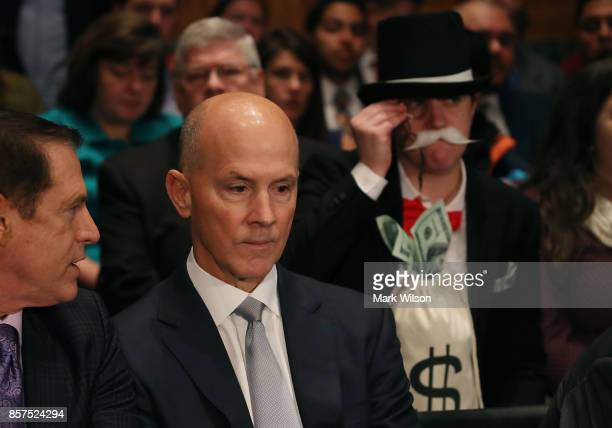 Former Equifax CEO Richard Smith prepares to testify before the Senate Banking Housing and Urban Affairs Committee in the Hart Senate Office Building...