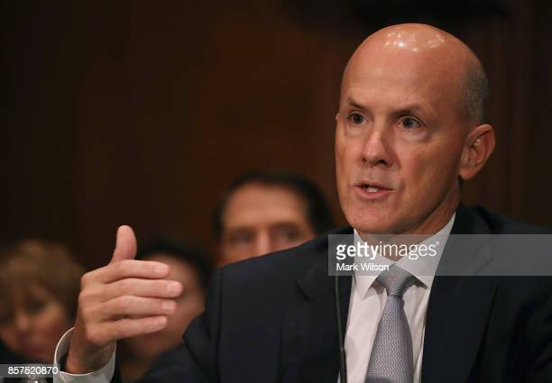 Former Equifax CEO Richard Smith testifies before the Senate Banking Housing and Urban Affairs Committee in the Hart Senate Office Building on...