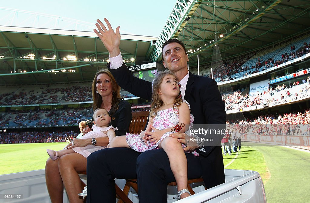 Former Essendon Champion Matthew Lloyd and his family wave to the fans as he is honoured before the round two AFL match between the Essendon Bombers...