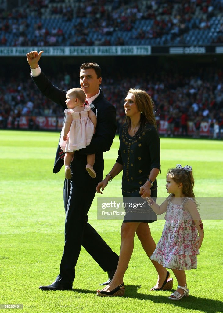 Former Essendon Champion Matthew Lloyd his wife Lisa Lloyd and daughters Jaeda Lloyd and Kira Lloyd walk onto the ground as he is honoured before the...
