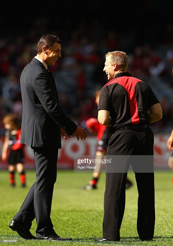 Former Essendon Champion Matthew Lloyd speaks with Matthew Knights coach of the Bombers before the round two AFL match between the Essendon Bombers...