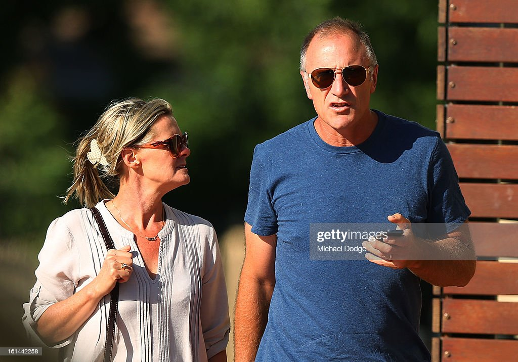 Former Essendon player Tim Watson and wife Susie Watson arrive ahead of a meeting between Essendon Bombers AFL staff, players and families at Windy Hill on February 11, 2013 in Melbourne, Australia.