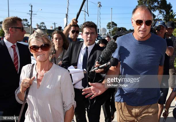 Former Essendon player Tim Watson and wife Susie Watson arrive ahead of a meeting between Essendon Bombers AFL staff players and families at Windy...