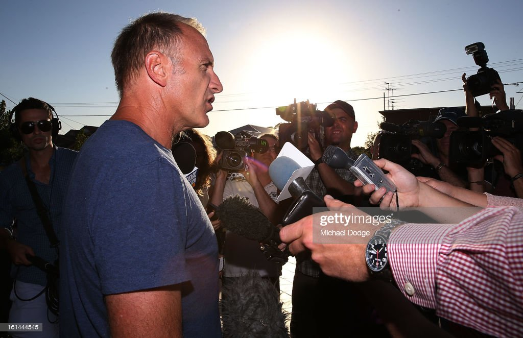 Former Essendon player Tim Watson talks to the media after leaving the meeting between Essendon Bombers AFL staff, players and families at Windy Hill on February 11, 2013 in Melbourne, Australia.