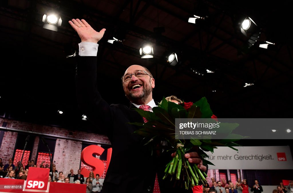 TOPSHOT - Former European parliament president and candidate for Chancellor of Germany's social democratic SPD party Martin Schulz reacts after his election as new SPD leader during the Congress of Germany's Social Democratic Party (SPD) on March 19, 2017 in Berlin. / AFP PHOTO / Tobias SCHWARZ