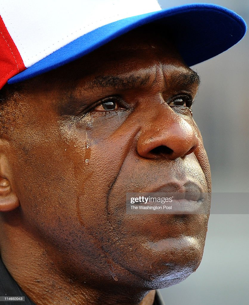 Former Expo Andre Dawson cries as he watches a video tribute during a ceremony to put his name on the ring of fame at Washington's Nationals Park in August.