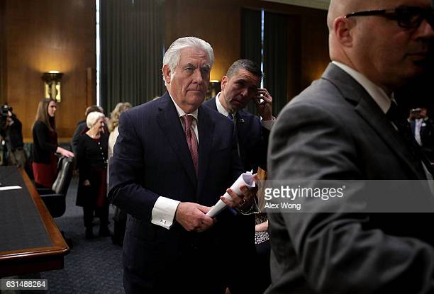 Former ExxonMobil CEO Rex Tillerson US Presidentelect Donald Trump's nominee for Secretary of State leaves the room for a lunch break during his...