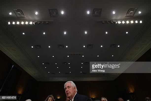 Former ExxonMobil CEO Rex Tillerson US Presidentelect Donald Trump's nominee for Secretary of State waits to resume testifying after a lunch break...