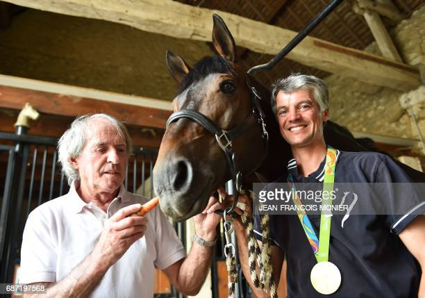 Former F1 racer Jacques Laffite and France's Karim Laghouag and his horse 'Entebbe de Hus' are pictured with the gold medal which he won at the Rio...
