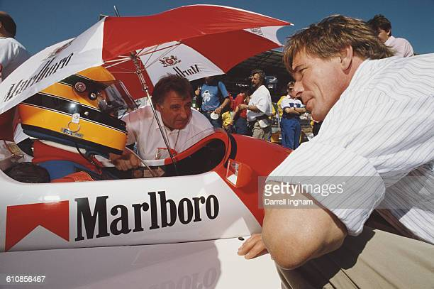Former F1 World Champion James Hunt talks to Eddie Irvine aboard the Pacific Racing Reynard 89D Mugen before the start of the FIA International F3000...