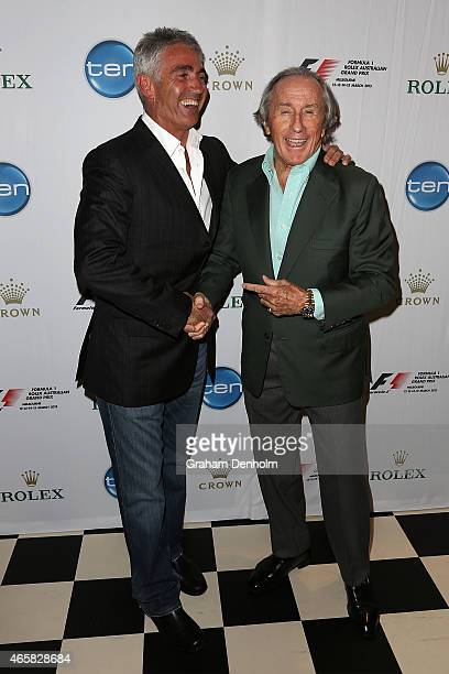 Former F1 World Champion Sir Jackie Stewart poses with former Grand Prix motorcycle road racing World Champion Mick Doohan during the GP@23 Official...