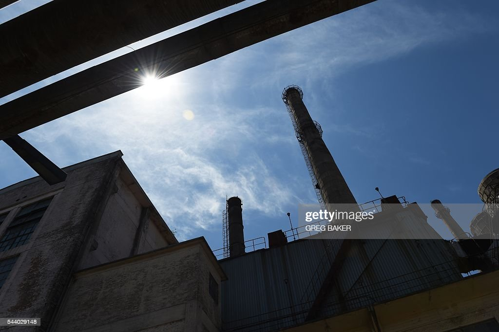 A former factory is seen in Beijing on July 1, 2016. Activity in Chinese factories suffered its sharpest deterioration for four months in June, figures showed on July 1, as weak demand and industrial overcapacity weighed on the world's second-largest economy. / AFP / GREG