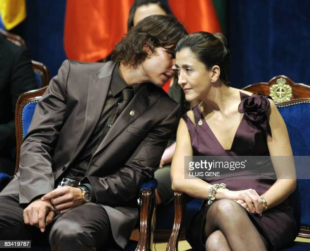 Former FARC hostage Colombian Ingrid Betancourt and Spanish tennis player Rafael Nadal talk before being awarded Prince of Asturias Awards from...