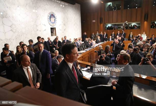 Former FBI Director James Comey arrives to testify before the Senate Intelligence Committee in the Hart Senate Office Building on Capitol Hill June 8...