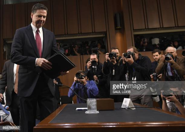 Former FBI Director James Comey arrives to testify during a US Senate Select Committee on Intelligence hearing on Capitol Hill in Washington DC June...
