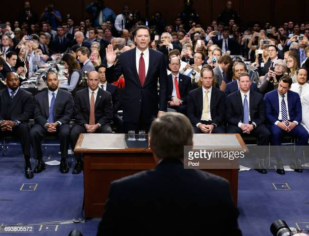 Former FBI Director James Comey is sworn in before testifing before the Senate Intelligence Committee in the Hart Senate Office Building on Capitol...