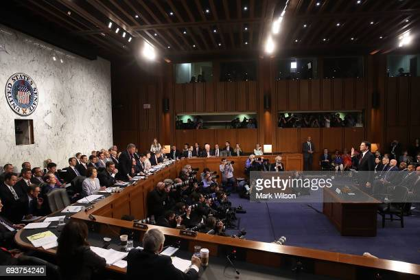 Former FBI Director James Comey is sworn in before testifying before the Senate Intelligence Committee in the Hart Senate Office Building on Capitol...