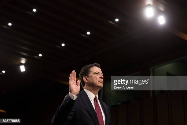 Former FBI Director James Comey is sworn in before the Senate Intelligence Committee in the Hart Senate Office Building on Capitol Hill June 8 2017...